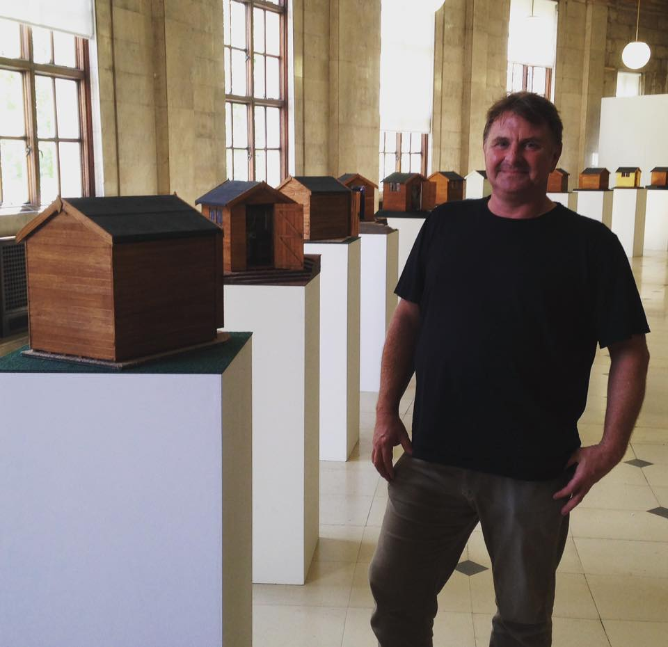 Artist Richard Bartle with sheds - Deities at the Bottom of the Garden touring exhibition