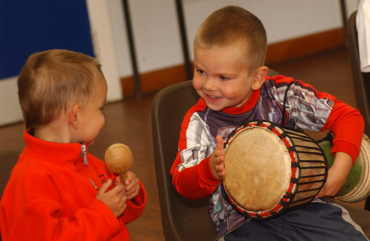 Two boys playing with drums