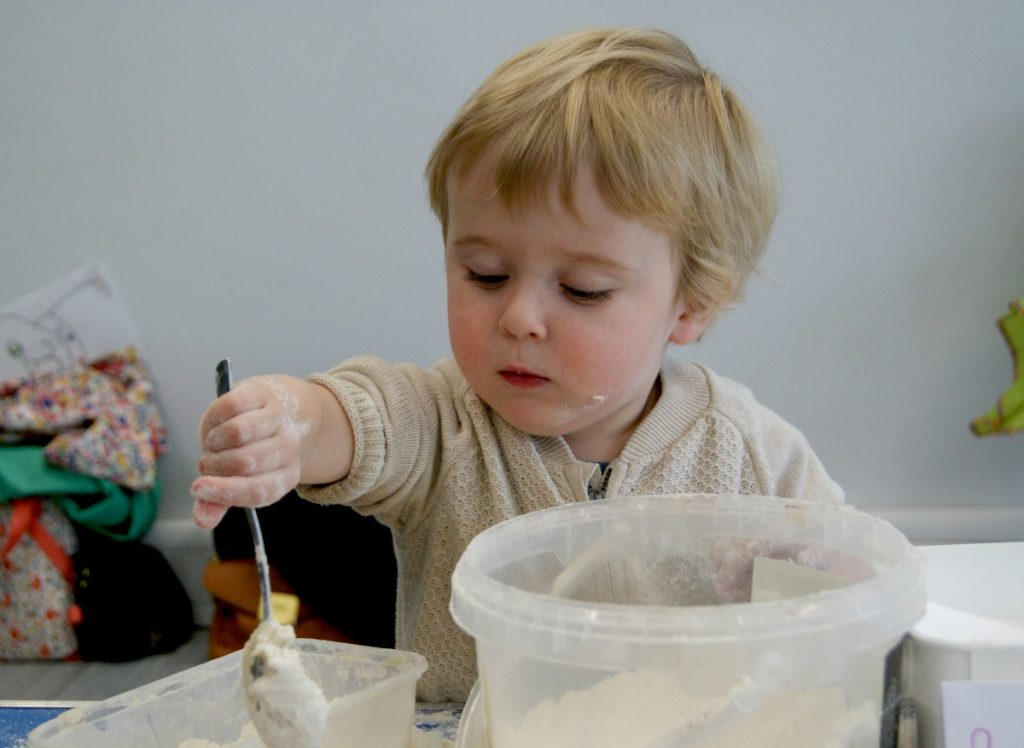 Child playing with clay, Stick and Splodge, 20-21 Visual Arts Centre