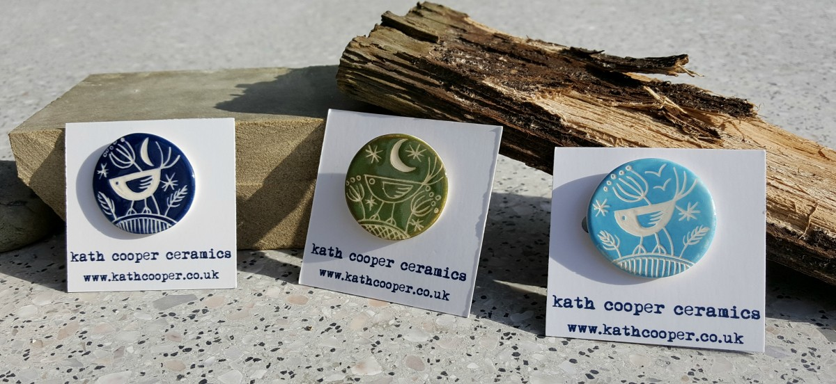 Kath Cooper Ceramics - Selection of three bird badges in dark blue, green and light blue