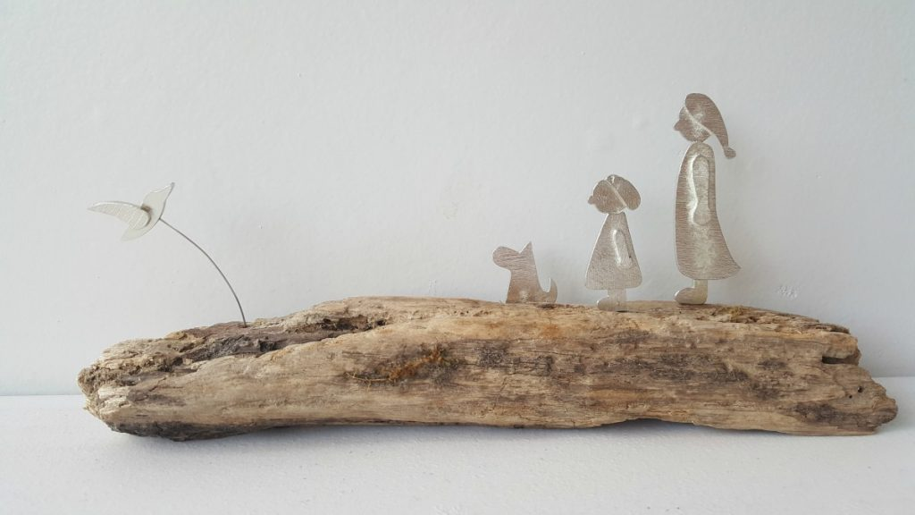 Yvette Brown - Woman, little girl and dog with bird flying by. Wooden base.