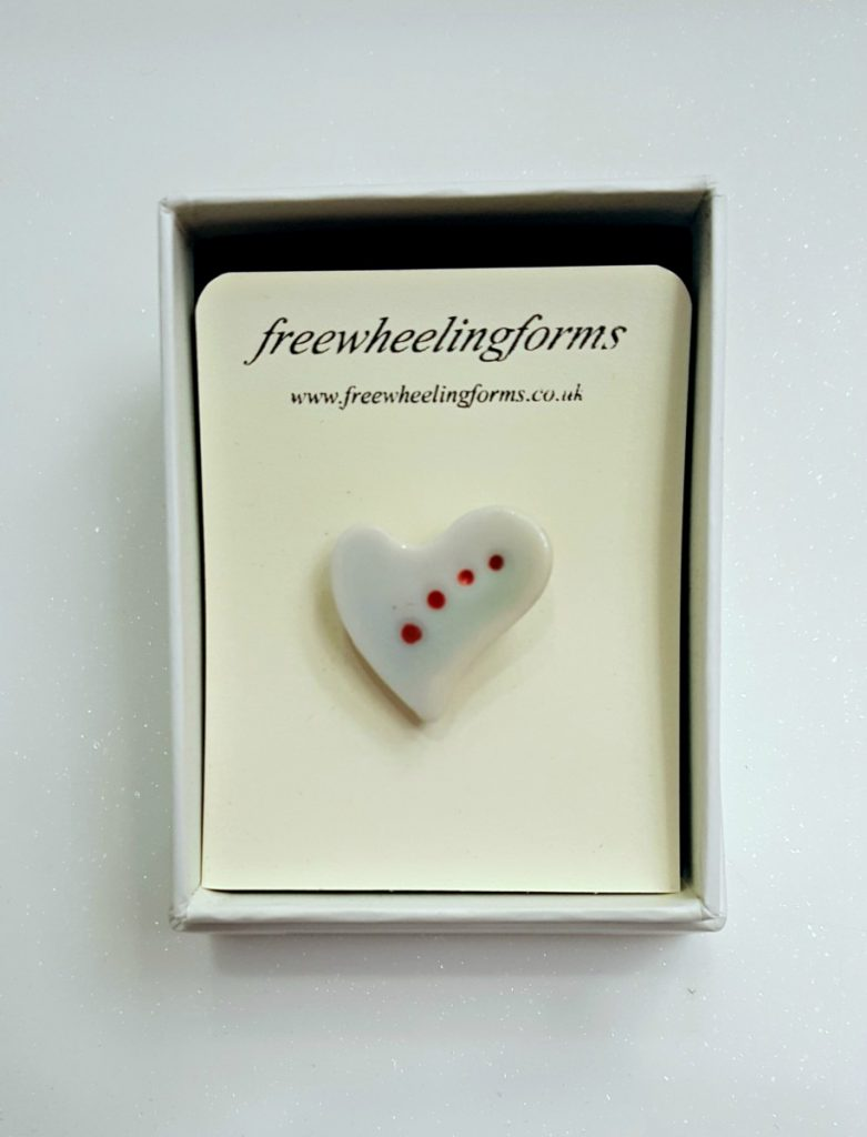 Freewheeling Forms White Heart Brooch with Red Spots