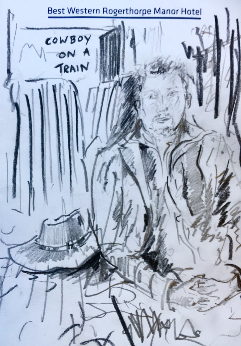 Charcoal drawing on hotel paper of a cowboy on a train, by Joss Cole