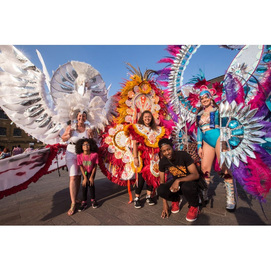 Members of Emccan show off three of their carnival costumes