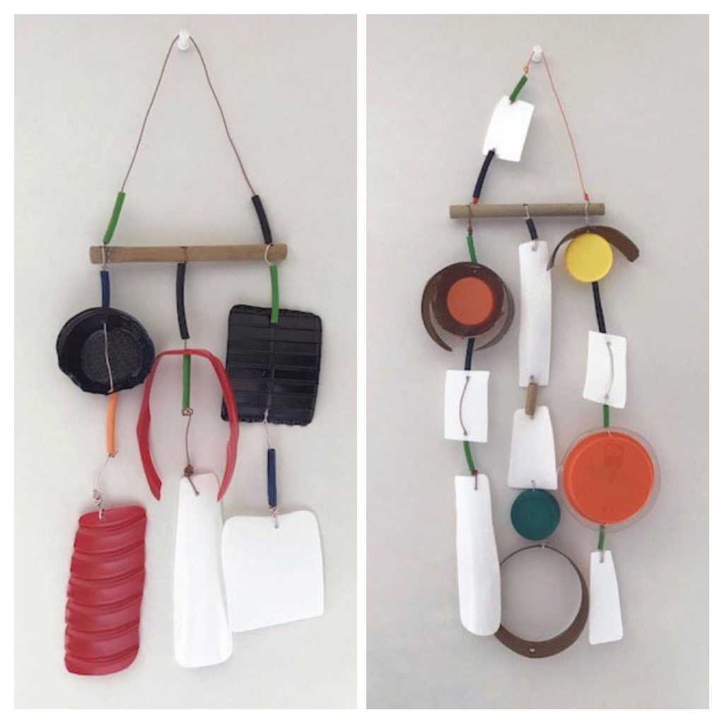 Two hanging sculptures made of recycled materials