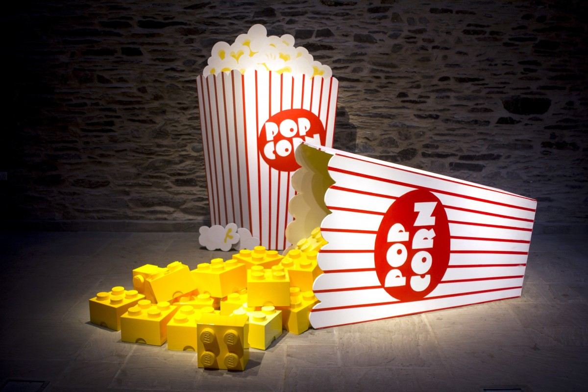 art image of lego pieces coming out of popcorn boxes