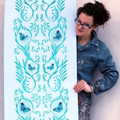 Sarah Jane Palmer with one of her wallpaper designs