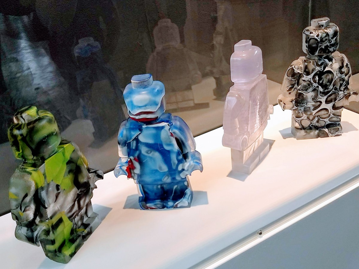 Four sculptural cast glass minifigures by Hannah Gibson