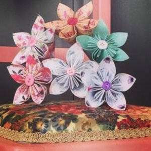 a bunch of decorative origami flowers by Diana May
