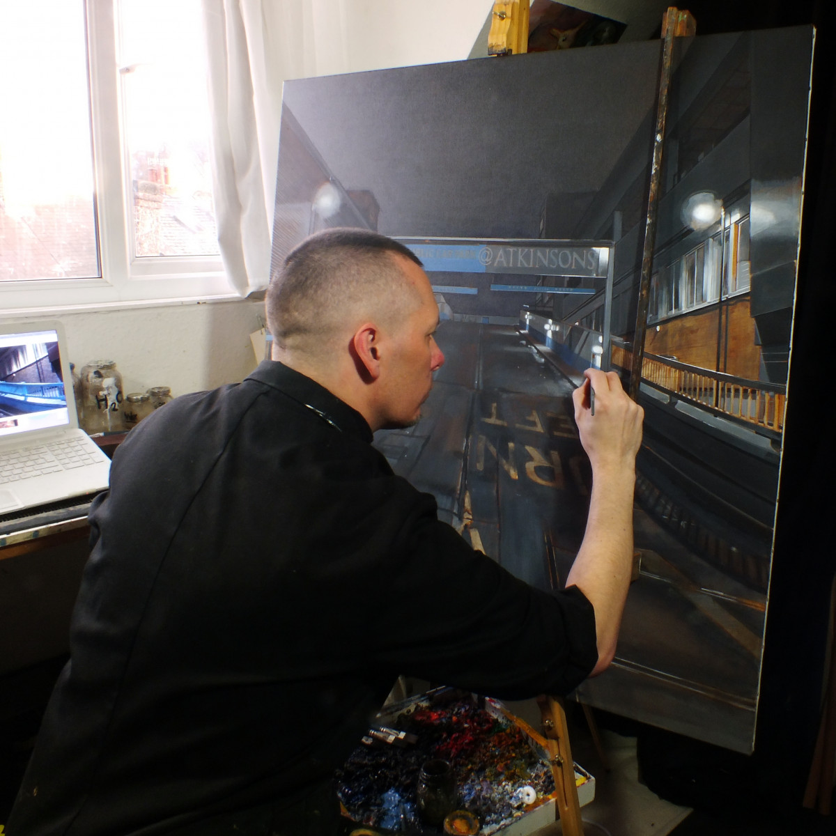 Photograph of Andy Cropper at work in his studio