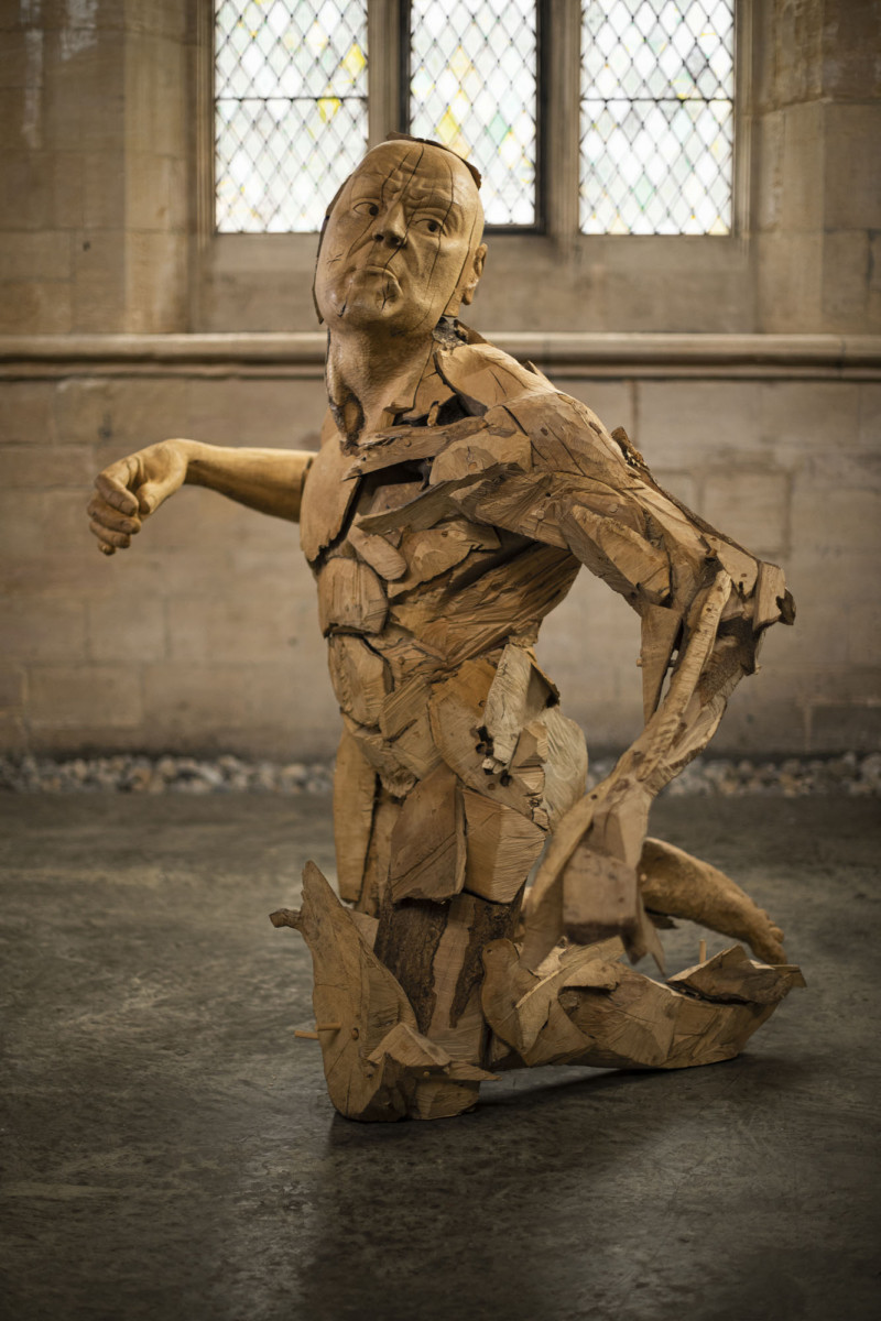 The Gaslighter's Comeuppance by Jamie Frost - a large sculpture of a man carved from holly