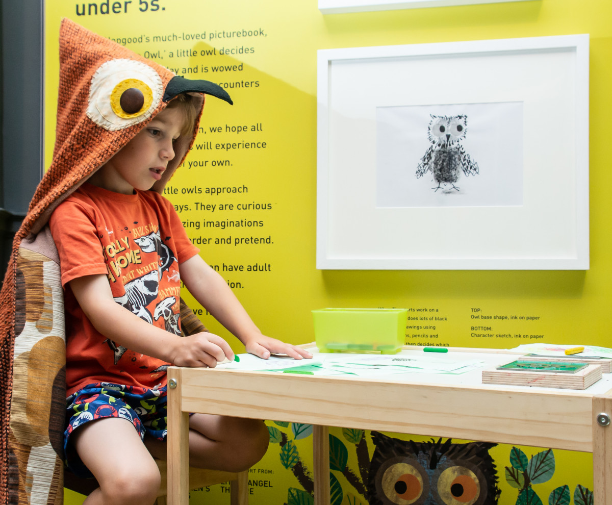 Photo of young boy doing activities in the WOW! Said the Owl exhibition