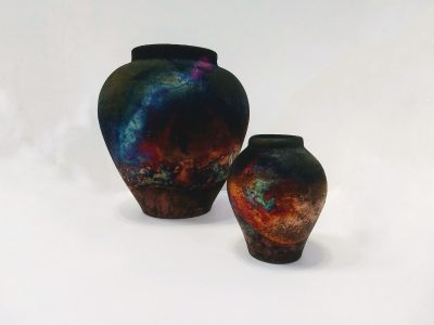Two Raku vases by Pat Armstrong, with abstract iridescent glazes