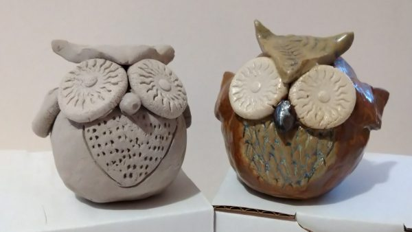 Two example clay owls from the Karen Raithby workshop, before and after glazing