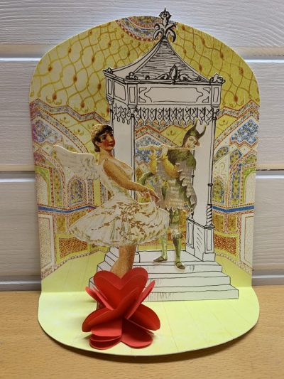 Pop-up Victorian style Christmas card showing dancers against an ornate background