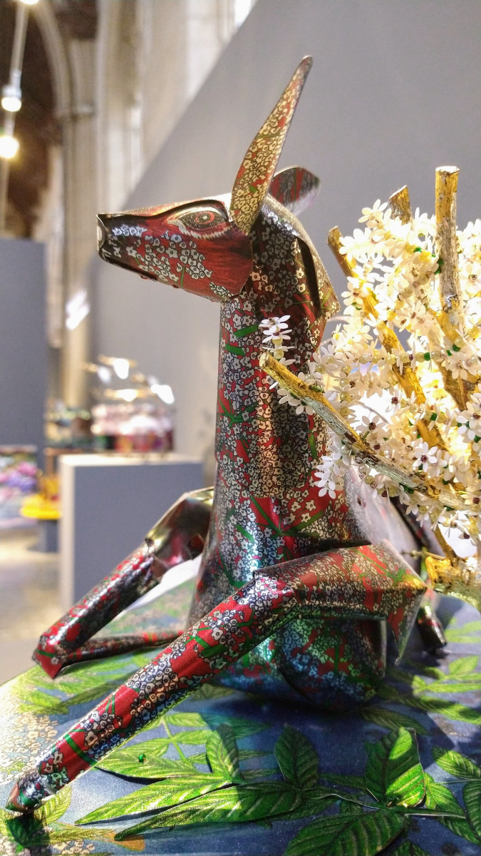 Melanie Tomlinson's sculpture And Then I Saw a Deer, showing a deer created from shaped metal sheets printed with a floral pattern.
