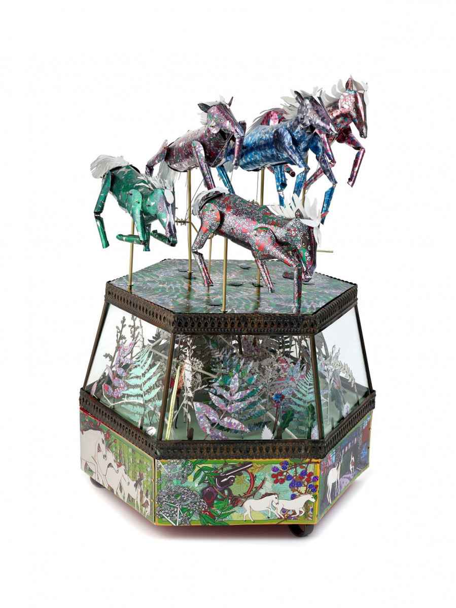 Ghost Horses and Guns by Melanie Tomlinson, showing a decorated hexagonal base with five colourful jointed metal horses mounted on top