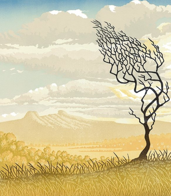 Linocut print of windswept bare tree silhouetted against an open view of distant hills