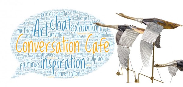three of Melanie Tomlison's mechanical swans in front of a speech bubble word cloud of words and phrases associated with Conversation Cafe