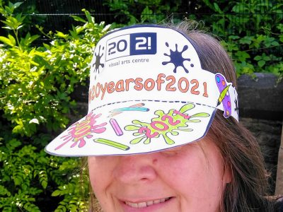 Papercraft sun hat with colourful art-themed decoration