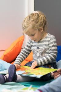 Girl reading book on her lap
