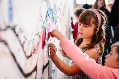 Girls working on wall