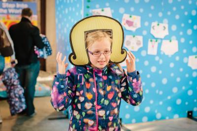 Girl in cardboard wig