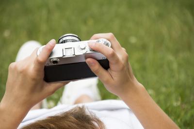 Stock photo: Girl holding camera